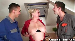 Horny granny pleases two repairmen