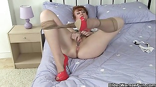 British milf Crimson peels off her pantyhose and fucks herself